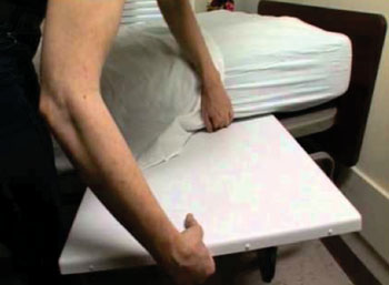 Image: The Virtual Medical Assistant placed under a mattress (Photo courtesy of Sensiotec).