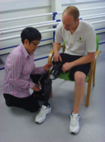 Image: Dr. Liudi Jiang fitting the liner to a prosthetic limb (Photo courtesy of the University of Southampton).