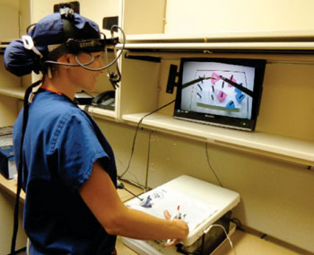 Image: Measuring the speed of saccadic eye movement during simulated laparoscopic tests (Photo courtesy of the University of Granada).
