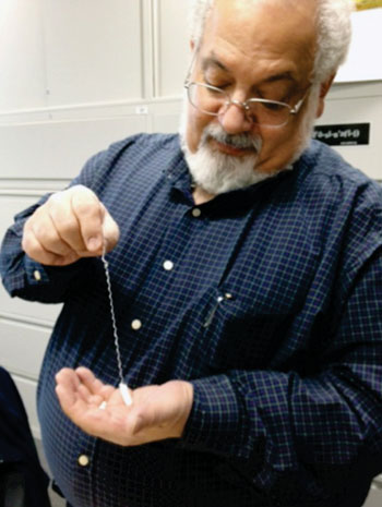 Image: Professor Steven Ackerman holding the EnteroTrack capsule device (Photo courtesy of UIC).
