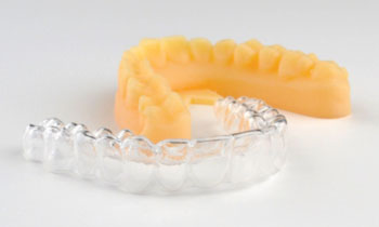 Image: ClearCorrect\'s clear orthodontic aligners are now all produced by 3D printing with Stratasys's Objet 3D Printers (Photo courtesy of Stratasys).