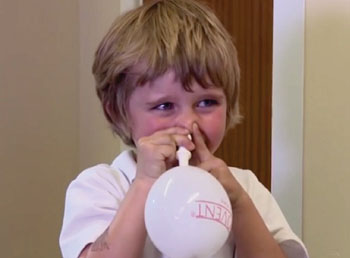 Image: A child autoinflating a nasal balloon (Photo courtesy of the University of Southampton).