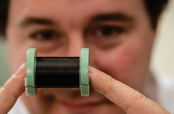 Image: Prof. Matteo Pasquali holding a spool of pure carbon nanotube fiber (Photo courtesy of Jeff Witlow/ Rice University).