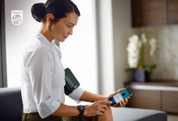 Image: The Philips upper arm blood pressure monitor and watch, connected to the app (Photo courtesy of Royal Philips).